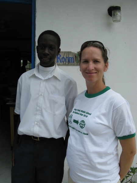 9th grader, Glenroy Miller, with Principal Joanna Paul